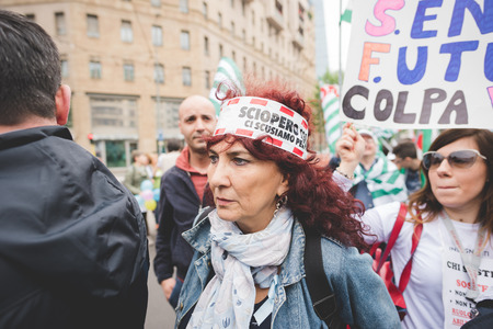 occupy: MILAN, ITALY - MAY 05: Students manifestation held in Milan on May, 5 2015. Students and teachers took to the streets to protest against new laws on education by minister Stefania Giannini