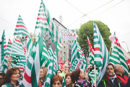 precarious: MILAN, ITALY - MAY 05: Students manifestation held in Milan on May, 5 2015. Students and teachers took to the streets to protest against new laws on education by minister Stefania Giannini
