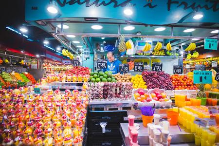 boqueria: BARCELONA, SPAIN - MARCH 21: La rambla Boqueria marketplace on March 21, 2015. Boqueria is the most famous marketplace in Barcelona, in front of la rambla street.