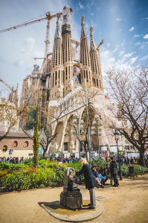 familia: BARCELONA, SPAIN - MARCH 21: Sagrada Familia on March 21, 2015. Sagrada Familia is a large Roman Catholic church in Barcelona, designed by architect Antoni Gaudí Editorial