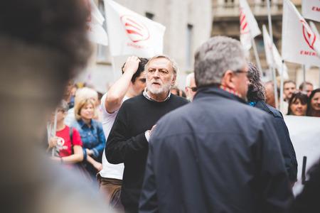 manifests: MILAN, ITALY - APRIL 25: Gino Strada at celebration of liberation held in Milan on April 25, 2015. Gino Strada manifests in Milan. He is founder of indipendent association Emergency Editorial