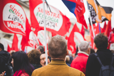 fascism: MILAN, ITALY - APRIL 25: celebration of liberation held in Milan on April 25, 2015. People took the streets in Milan to celebrate the 70th anniversary of the liberation of Italy from Nazism and Fascism Editorial
