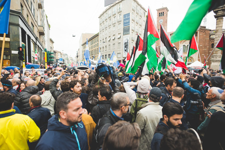 clashes: MILAN, ITALY - APRIL 25: celebration of liberation held in Milan on April 25, 2015. People took the streets in Milan to celebrate the 70th anniversary of the liberation of Italy from Nazism and Fascism Editorial