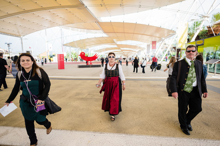 exposition: MILAN, ITALY - MAY 27: People visit Expo, universal exposition on the theme of food on MAY 27, 2015 in Milan Editorial