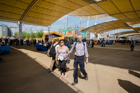 the world expo: MILAN, ITALY - MAY 27: People visit Expo, universal exposition on the theme of food on MAY 27, 2015 in Milan Editorial