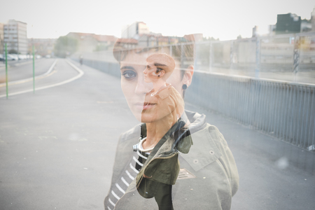 introspective: Double exposure half length portrait of young handsome caucasian brown straight hair woman, portrait and knee figure - creative, artistic, dreamy concept