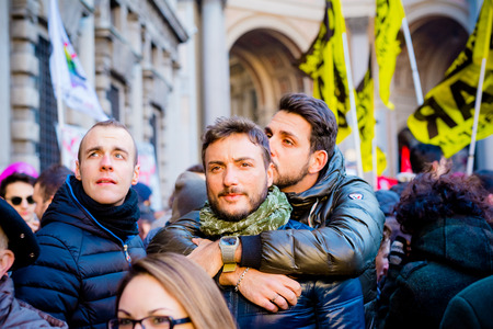 fro: MILAN, ITALY - JANUARY 23: unmarried couples manifestation in Milan on January 23, 2016. gay couple hugging during manifestation fro equal civil rights