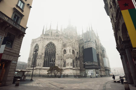 gothic build: View of the Milan Cathedral with fog that covers the pinnacles of Minster