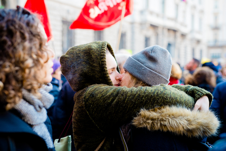 civil rights: MILAN, ITALY - JANUARY 23: unmarried couples manifestation in Milan on January 23, 2016. people manifesting for unmarried gay, lesbians and heterosexual equal civil rights couples - couple kissing