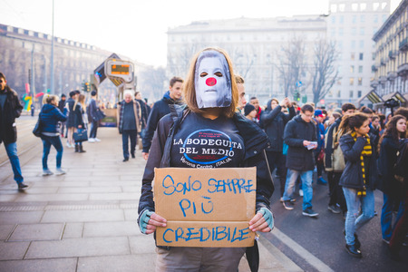 credible: MILAN, ITALY - JANUARY 29: students demonstrating against the meeting between Marie Le Pen and Matteo Salvini on Milan on January 29, 2016. Student masked with banner saying Im more credible anyway