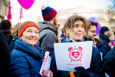 manifestation: MILAN, ITALY - JANUARY 23: unmarried couples manifestation in Milan on January 23, 2016. Two women manifesting holding banner saying Wake up italy