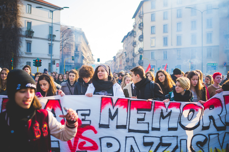 demonstrator: MILAN, ITALY - JANUARY 29: students demonstrating against the meeting between Marie Le Pen and Matteo Salvini on Milan on January 29, 2016. Crowd marching against racism, fascism and sessism Editorial