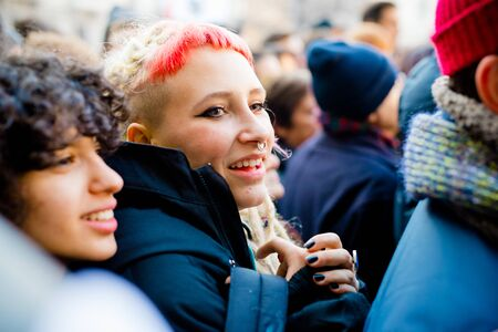 gay girl: MILAN, ITALY - JANUARY 23: unmarried couples manifestation in Milan on January 23, 2016. Girl manifesting for unmarried gay, lesbians and heterosexual equal civil rights couples