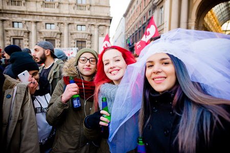 civil rights: MILAN, ITALY - JANUARY 23: unmarried couples manifestation in Milan on January 23, 2016. Girls manifesting for unmarried gay, lesbians and heterosexual equal civil rights couples