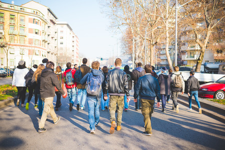 fascism: MILAN, ITALY - JANUARY 29: students demonstrating against the meeting between Marie Le Pen and Matteo Salvini on Milan on January 29, 2016. Rear view of crowd marching against racism, fascism and sessism