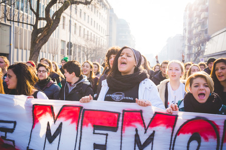 fascism: MILAN, ITALY - JANUARY 29: students demonstrating against the meeting between Marie Le Pen and Matteo Salvini on Milan on January 29, 2016. Crowd marching against racism, fascism and sessism Editorial