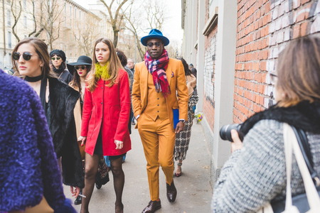 Milan, Italy - February 25, 2016: people attending models and vips in the streets during Milan Fashion Week Women FallWinter 20152016