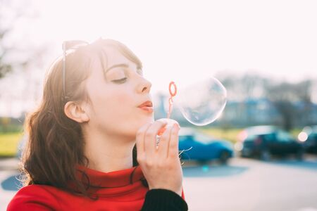 half length: Half length of young beautiful woman wearing sunglasses playing with bubble soap - childhood, youthful concept