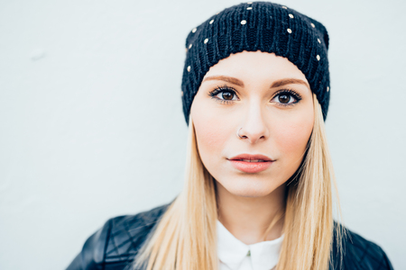 nostril: Portrait of young beautiful caucasian blonde hair woman with nostril piercing, looking in camera serene - youth, carefree, serenity concept Stock Photo