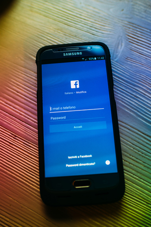 mark zuckerberg: MILAN, ITALY - JANUARY 10: Samsung S6 opened to Facebook app. Facebook is very well known social networking service founded in 2004 by Mark Zuckerberg with more than 1,4 billion of users Editorial