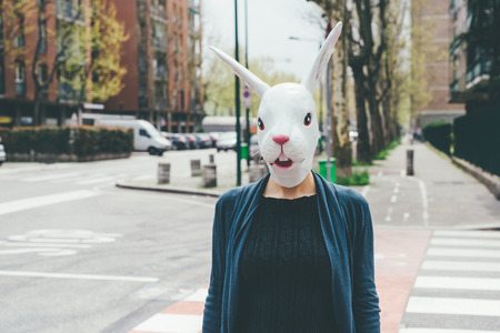 dreamlike: Half length woman wearing rabbit mask outdoor in the city - halloween, dreamlike, strange concept