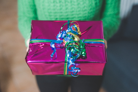 Close up on a gift wrapped with colorful ribbon