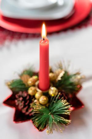 Close up on burning chrismas candle decoration Zdjęcie Seryjne