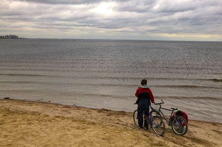 original bike: Boys with bicycles on a beach.