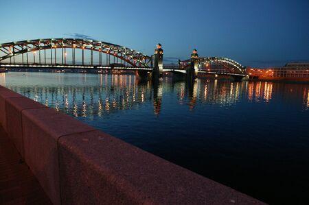 iuml: Night city. Lighteandamp,acirc, bridges and buildings.Bolsheohtinskiy bridge.