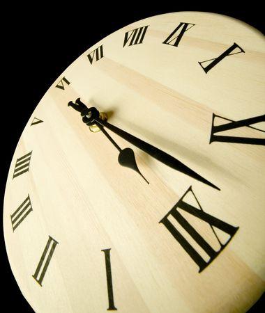 piter: Wooden clock on black