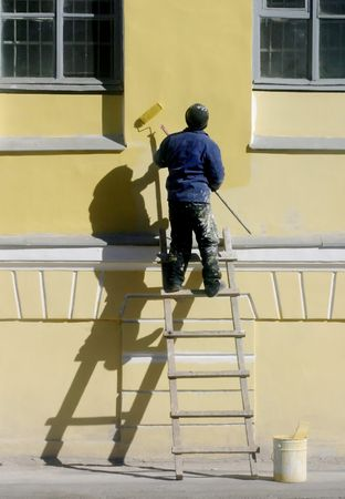 bolster: worker color the wall Stock Photo