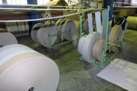 Roll of paper in a paper factory photo