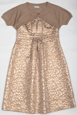 nitid: Womens beige dress. The pattern on fabric. Knitted item. On a white background.