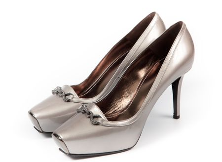 clasp feet: female shoes on a white background
