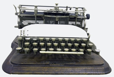 A printing press is a mechanical device for applying pressure to an inked surface photo