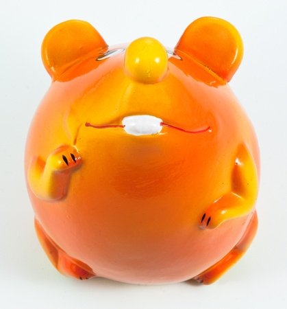 Ceramic moneybox. Toy mouse. On a white background. photo