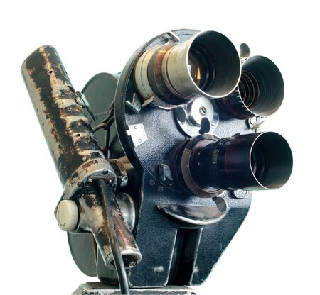 filmmaker: An antique movie camera isolated on white