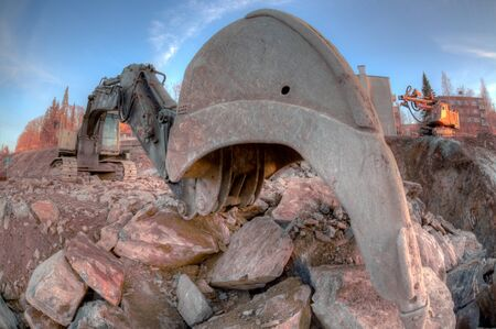 front end: Scoop of the excavator close up. Part of land vehicle. Stock Photo