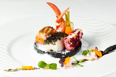 Fine Seafood dish on the white plate Nobody