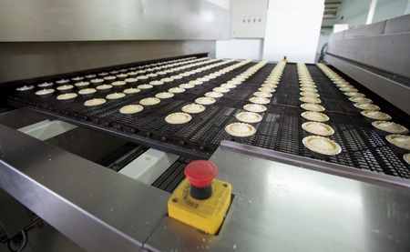 Pastry. Pastry on a conveyor. A lot of cookies. photo