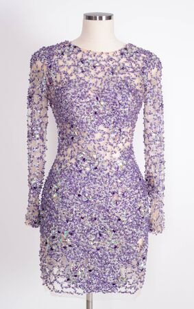 Elegant womens dresses with sequins dressed on a mannequin. photo