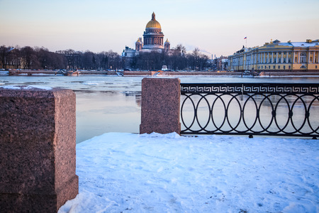 St. Isaacs Cathedral - view across the Neva River from the Vasilievsky Island. Russian winter. Twilight. photo
