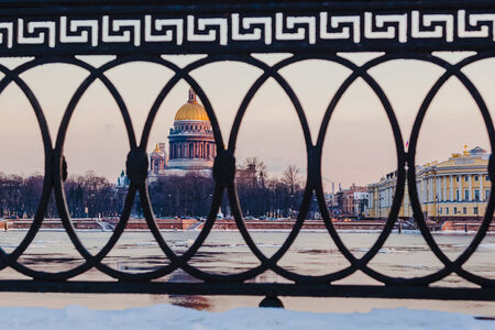 iconic: St. Isaacs Cathedral - view across the Neva River from the Vasilievsky Island. Russian winter. Twilight.