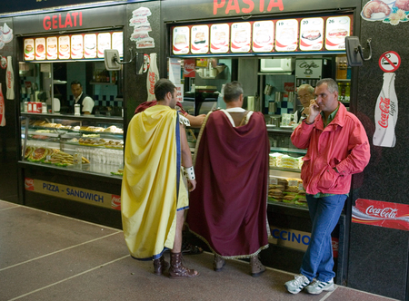 dearth: Men dressed in costumes ancient warrior  in cafe.