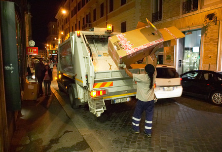 bionomics: Italy. Rome. Night city. Cleaning of dust in streets. The machine for export of dust.
