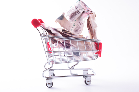 inflation basket: shopping trolley with crumpled ruble banknotes