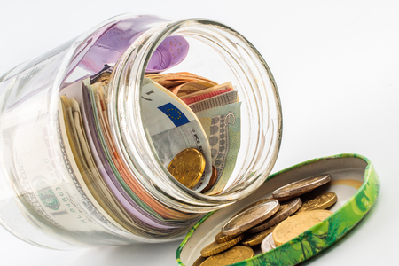 accountancy: A jar of cash on the white background. Stock Photo