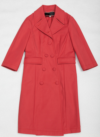 mackintosh: Red shining a female dress with buttons Stock Photo