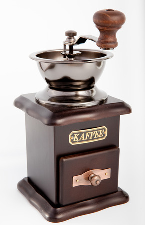 Retro Coffee grinder on the white background photo