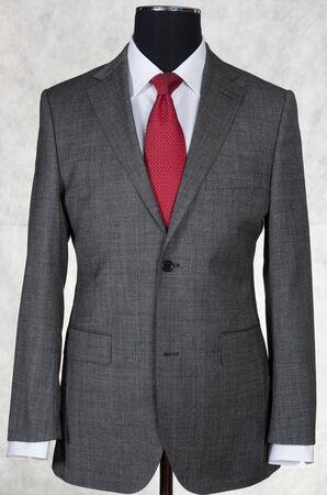 layman: Dummy on white background. Gray suit Stock Photo